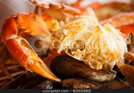 Dish with crab and mussels stock photo, Dish with crab and mussels. Selective focus on the claw by Iryna Rasko