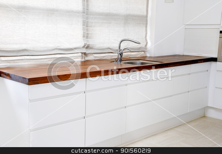 Modern kitchen stock photo, A modern white kitchen. by Lars Christensen