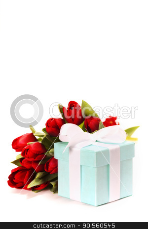 gift box with flowers stock photo, Single blue gift box with white ribbon and flowers on white background. by klenova