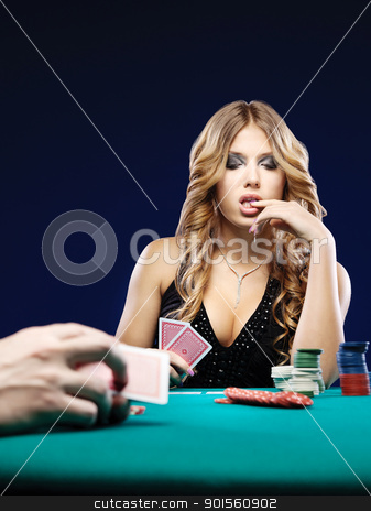Woman doubt in a card gambling match stock photo, Woman doubt in a card gambling match on green table by iMarin