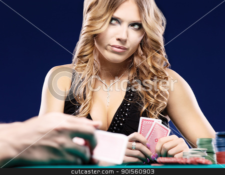 Woman doubt in a card gambling match stock photo, Blond woman doubt in a card gambling match by iMarin