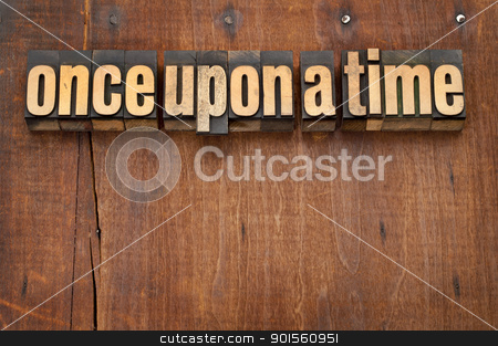 once upon a time opening phrase stock photo, once upon a time opening phrase - storytelling concept - vintage letterpress wood type text against grunge weathered wooden background by Marek Uliasz
