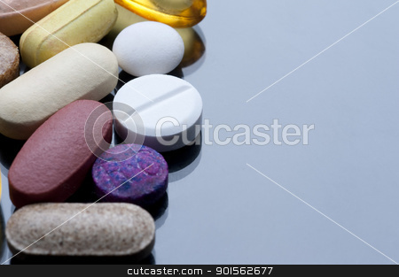 Drug Cocktail stock photo, a cocktail of various tablets and pills, drugs and health supplements. by Stephen Gibson