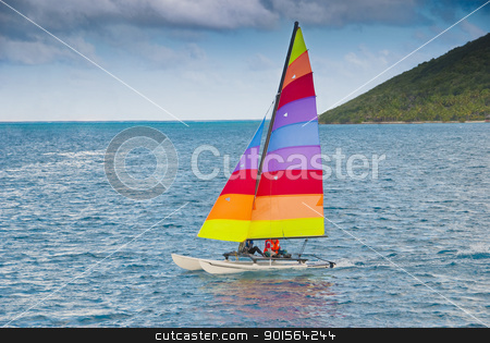 Small catamaran sailboat stock photo, Small catamaran sailboat in the caribbean by Christian Delbert