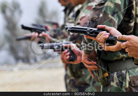 soldier stock photo, Soldier while charging a gun by vinciber