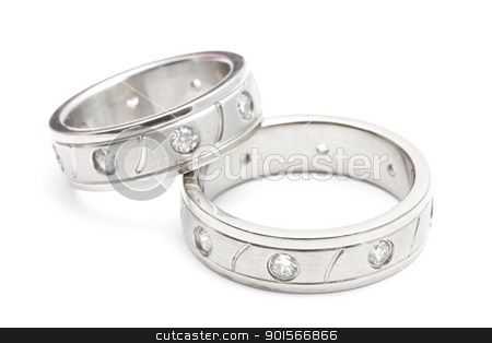 Wedding rings stock photo, Wedding rings isolated on white background by Ingvar Bjork