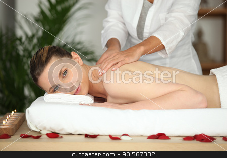 Girl having back massage in beauty parlor stock photo, Girl having back massage in beauty parlor by photography33