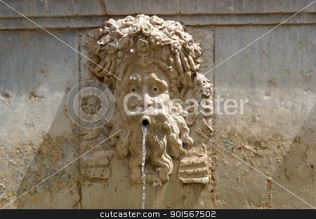 Funny mascaron face on fountain in Alhambra, Granada, Spain stock photo, Funny mascaron face on fountain in Alhambra, Granada, Spain by Shlomo Polonsky