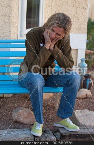 Sad lonley mature woman stock photo, Woman sitting on bench depressed and frustrated by Gunter Nezhoda