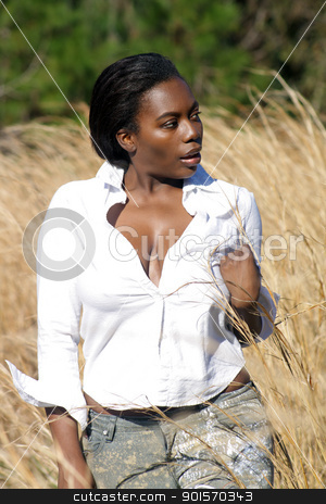 Beautiful Woman Outdoors in Tall Grass (8) stock photo, A lovely young black woman outdoors, standing in tall grass. by Carl Stewart