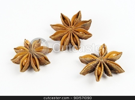Star anise triple on white background stock photo, Three open fruits of star anise (Illicium verum) showing the seeds are arranged in a triangle.  by TheOrganic
