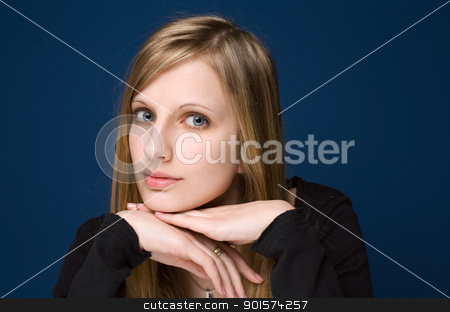 Graceful friendly young blond woman. stock photo, Portrait of a graceful friendly young blond woman on blue background. by exvivo