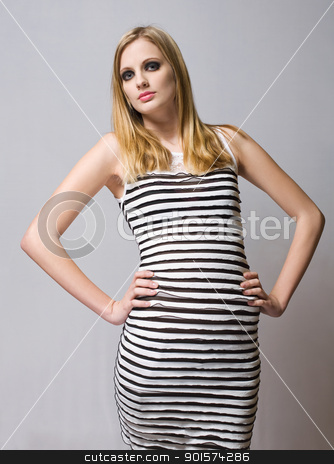 Young blond fashion model. stock photo, Portrait of a young blond fashion model in strong makeup and dark eye shade. by exvivo