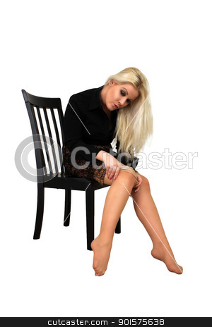Beautiful Blonde Putting on Panty Hose (1) stock photo, A lovely, glamourous young blonde puts on her panty hose.  Isolated on a white background with generous copyspace. by Carl Stewart