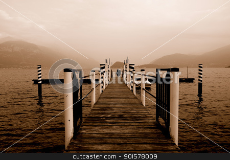 Vintage dock stock photo, A dock on the banks of lake of Como in Sepia by Maurizio Martini
