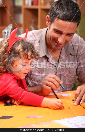 Father and son celebrating Halloween stock photo, Father and son celebrating Halloween by photography33