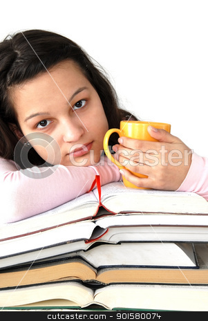 Teenage girl with books and cup stock photo, caucasian teenage girl sitting at the desk with stack of opened books and tea cup by Julija Sapic