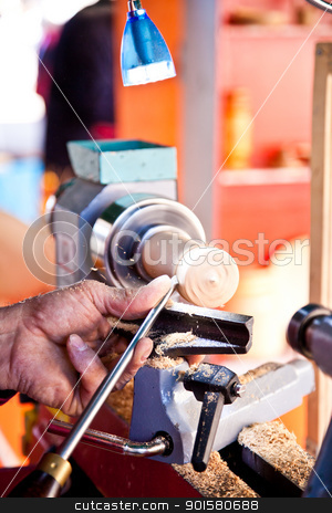 Turner at work stock photo, Old worker hands at lathe by Perseomedusa