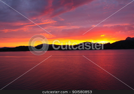 sunset view from a boat off the coast of norway stock photo, sunset view from a boat off the coast of norway by Chretien