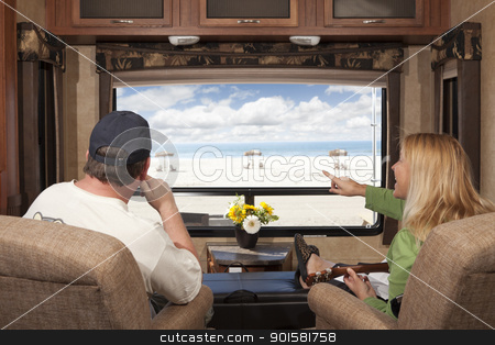 Couple Enjoy Beach View From RV stock photo, Young Couple Enjoying the Beach View From Their 5th Wheel RV.  by Andy Dean