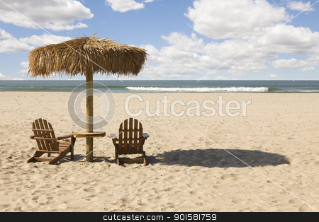 Two Beach Chairs and Umbrella on Beautiful Ocean Sand stock photo, Two Beach Chairs and Umbrella on a Beautiful Ocean Front with Copy Space. by Andy Dean