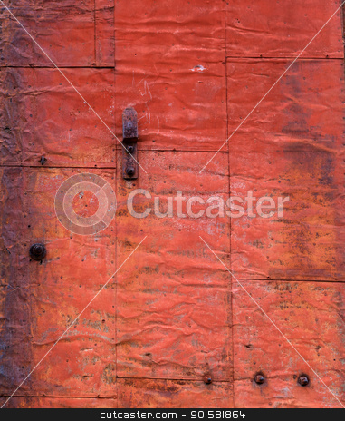 Old Rusted Steel Door stock photo, Red brown and orange rusted and weathered steel sliding door by bobkeenan