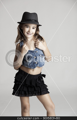 Fashion little girl stock photo, Fashion portrait of a little girl looking at the camera, over a gray background by ikostudio