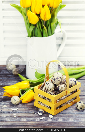 easter composition stock photo, easter composition with eggs and spring flowers on old wooden boards by klenova