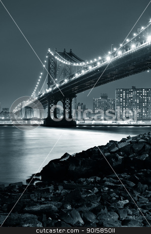 Manhattan Bridge stock photo, New York City Manhattan Bridge closeup black and white with downtown skyline over East River. by rabbit75_cut