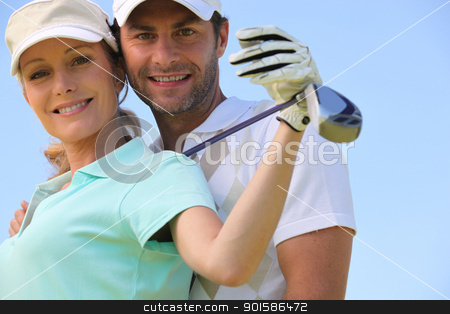 Golfing couple stock photo, Golfing couple by photography33