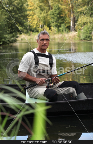 Fisherman in a boat stock photo, Fisherman in a boat by photography33