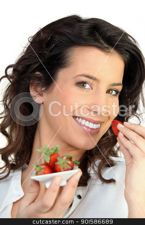 Woman eating strawberries stock photo, Woman eating strawberries by photography33