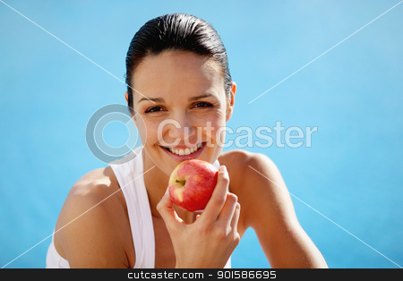 Cheerful woman eating an apple stock photo, Cheerful woman eating an apple by photography33