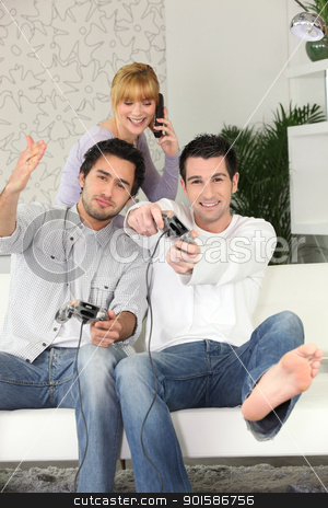 Young people playing computer games stock photo, Young people playing computer games by photography33
