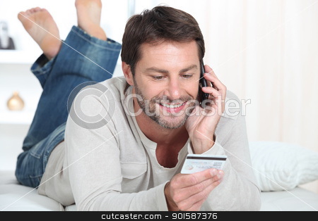 Man topping up phone stock photo, Man topping up phone by photography33