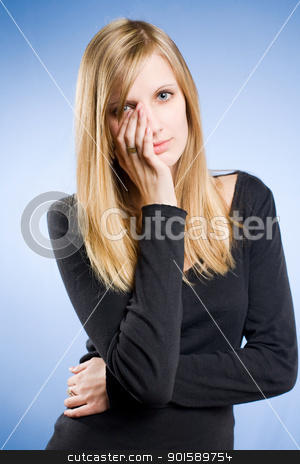 Tired and wasted. stock photo, Half length portrait of a tired and worried looking young blond woman. by exvivo