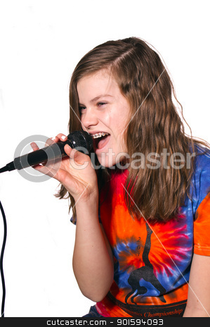 Teen Girl singing in a microphone stock photo, Teen Girl singing in a microphone with tie dye shirt isolated against white background by Bruce Hamms