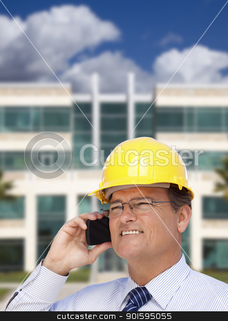 Contractor in Hardhat Talks on Phone In Front of Building stock photo, Handsome Contractor in Hardhat and Necktie Smiles as He Talks on His Cell Phone in Front of Building. by Andy Dean