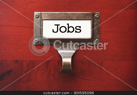 Lustrous Wooden Cabinet with Jobs File Label stock photo, Lustrous Wooden Cabinet with Jobs File Label in Dramatic LIght. by Andy Dean