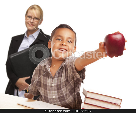 Hispanic Student Boy with Apple and Female Adult Behind. stock photo, Hispanic Student Boy At Desk with Apple and Female Adult Behind. by Andy Dean