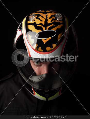 Man with helmet stock photo, Man with motorcycle helmet on black background by Anne-Louise Quarfoth