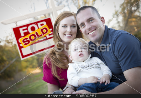 Happy Young Family in Front of Sold Real Estate Sign stock photo, Happy Young Caucasian Family in Front of Sold Real Estate Sign. by Andy Dean