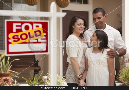 Hispanic Family in Front of Home with Sold Real Estate Sign stock photo, Hispanic Mother, Father and Daughter in Front of Their New Home with Sold Home For Sale Real Estate Sign. by Andy Dean