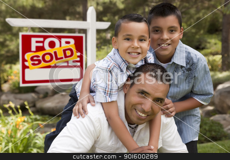 Hispanic Father and Sons in Front of Sold Real Estate Sign stock photo, Hispanic Father and Sons in Front of a Sold Home For Sale Real Estate Sign. by Andy Dean