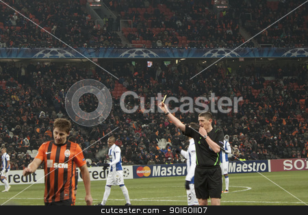 Referee Craig Thomson (SCO) shows a yellow card stock photo, DONETSK, UKRAINE - NOVEMBER 23, 2011: Referee Craig Thomson (SCO) shows a yellow card Eduardo (Shakhtar) in the match of the Champions League FC Shakhtar Donetsk vs. FC Porto in Donetsk Donbass Arena on November 23, 2011. by virin