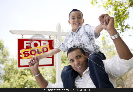 Hispanic Father and Son with Sold Real Estate Sign stock photo, Excited Hispanic Father and Son in Front of Sold For Sale Real Estate Sign. by Andy Dean