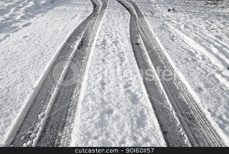 Close up tyre tracks in snow on a road. stock photo, Close up tyre tracks in snow on a road. by Stephen Rees