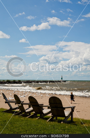 lake erie beach -adironak chairs, surf, sand, lighthouse & boy chasing seagulls  stock photo, lake erie beach in august with adironak chairs, big blue sky, surf, sand, lighthouse & boy chasing seagulls  by erin weber