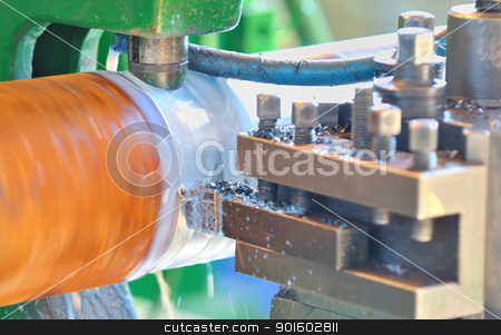 Turning lathe in action stock photo, Turning lathe in action by jordachelr