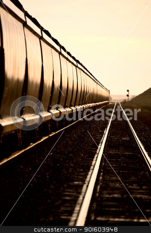 Train at Sunset stock photo, Train at Sunset late day Saskatchewan Canada by Mark Duffy
